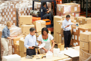 bigstock-Workers-In-Warehouse-Preparing-47469859